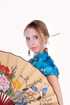 Beautiful Blonde In A Chinese Dress Royalty Free Stock Photo