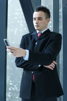 Free A Young And Handsome Business Man With A Phone Stock Image - 14115891