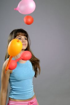 White Girl Playing With Balloons Royalty Free Stock Images