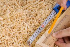 Free Hand And Wood Brick At Shavings Stock Photo - 14117460
