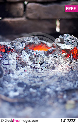 Free Burning Red Hot Coals On The Background Of Brick Stock Image - 14123231