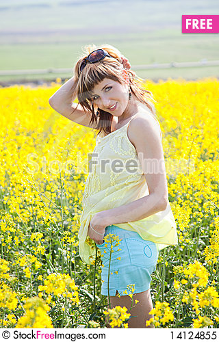 Free Girl In A Rapeseed Field Royalty Free Stock Photo - 14124855