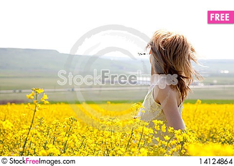 Free Girl In A Rapeseed Field Stock Images - 14124864