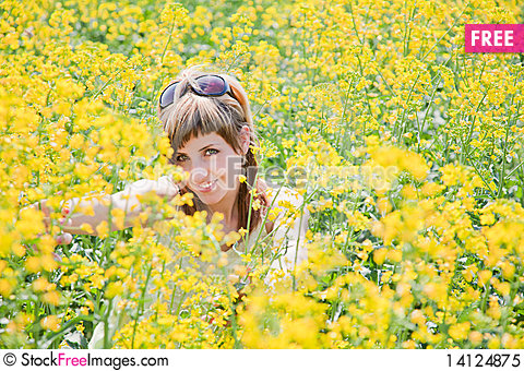 Free Girl In A Rapeseed Field Royalty Free Stock Photo - 14124875