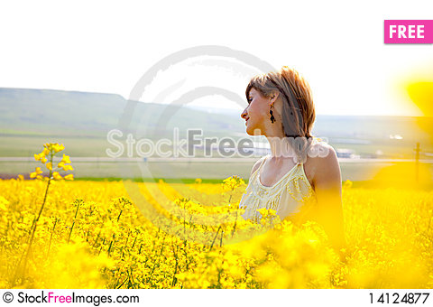 Free Girl In A Rapeseed Field Royalty Free Stock Photography - 14124877