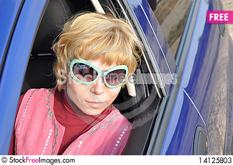 Free Car Series, Blonde And Green Sunglasses Stock Photos - 14125803