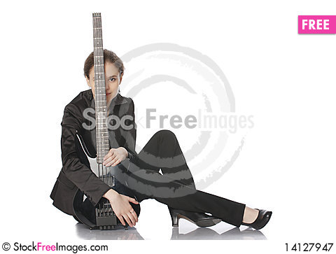 Free Seated Girl With A Black Electric Bass Guitar Royalty Free Stock Photography - 14127947