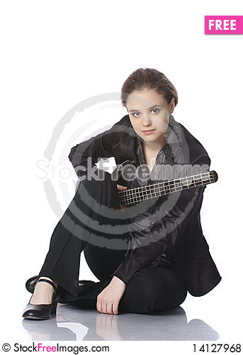 Free Seated Girl With A Black Electric Bass Guitar Royalty Free Stock Photos - 14127968