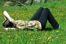 Girl Dreaming On The Grass Stock Photography