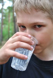 Water.Teenager Drinks From Can. Royalty Free Stock Photos