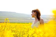 Girl In A Rapeseed Field Royalty Free Stock Photography
