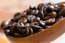 Fresh Roasted,coffee Beans In The Spoon,close Up Royalty Free Stock Photos
