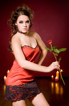 Free Sexy Girl With Rose On Red Stock Image - 14126601