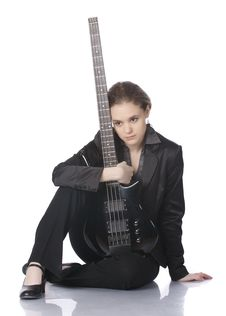 Free Seated Girl With A Black Electric Bass Guitar Stock Photos - 14127983