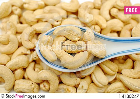 Free Spoonful Of Cashew Nuts Royalty Free Stock Photography - 14130247
