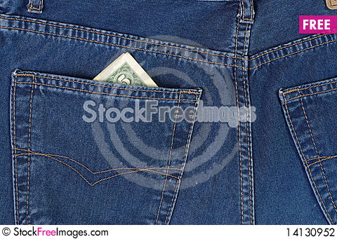 Dollars in blue jeans pocket Stock Photo