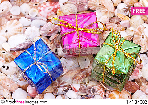 Free Present Boxes On Seashell Background Stock Photography - 14134082