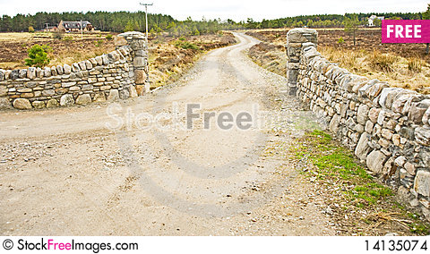 Free Stone Wall Entrance To House On The Hill. Stock Images - 14135074
