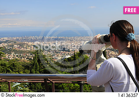 Free Woman Looking Through A Coin Operated Binoculars Royalty Free Stock Photography - 14136357