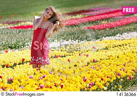 Free Beautiful Girl In Yellow And Red Tulips Royalty Free Stock Image - 14136366