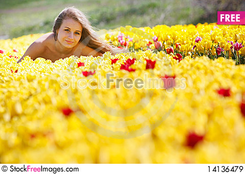 Free Beautiful Girl In Yellow Tulips Royalty Free Stock Images - 14136479