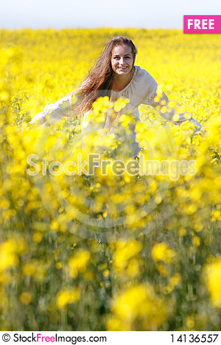 Free Happy Girl In Yellow Flowers Royalty Free Stock Photography - 14136557