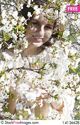 Free Young Beautiful Girl In Spring Flowers Royalty Free Stock Photos - 14136628