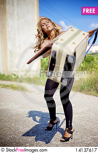Free Blond Woman And Bag Royalty Free Stock Photography - 14137617