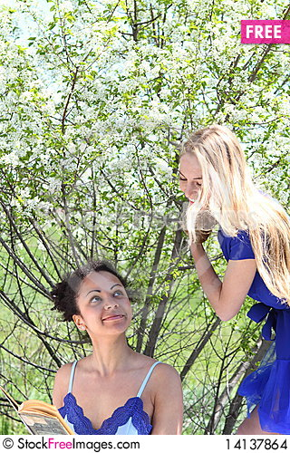 Free Two Girls In Blue In The Garden Stock Images - 14137864