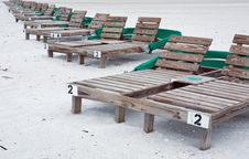 Wooden Beach Lounge Chairs Stock Images
