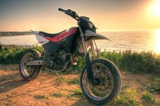 Free Motorcycle Enduro And Sunset On The Beach Stock Photos - 14132983