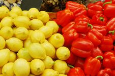 Close Up Of Lemons And Red Peppers Royalty Free Stock Images