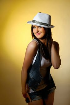 Free Young Sexy Model In Jeans And White Hat Royalty Free Stock Images - 14134529