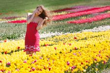 Beautiful Girl In Yellow And Red Tulips