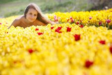 Beautiful Girl In Yellow Tulips