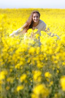 Happy Girl In Yellow Flowers Royalty Free Stock Photography