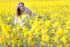 Happy Girl In Yellow Flowers Stock Photo