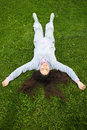 Free Girl Lying Upside Down On Fresh Grass Royalty Free Stock Images - 14140389