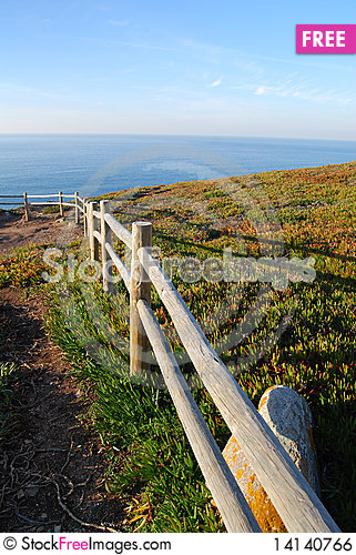 Free Cliff Fence Over The Sea Royalty Free Stock Image - 14140766