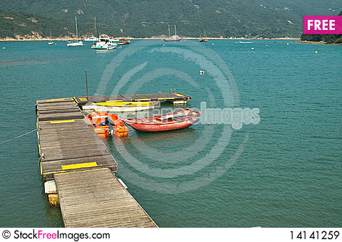 Free Little Pier With Boats Royalty Free Stock Images - 14141259
