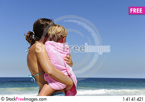 Free Mother Carrying Her Daughter On The Beach Stock Image - 14141421