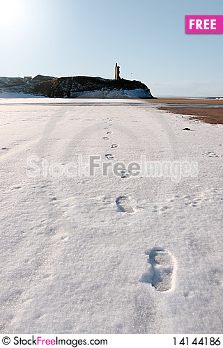 Free Footprints In Snow On  Beach With Castle Royalty Free Stock Image - 14144186