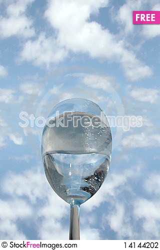 Free Glass Of Cool Water Against A Blue Sky Stock Photography - 14144202