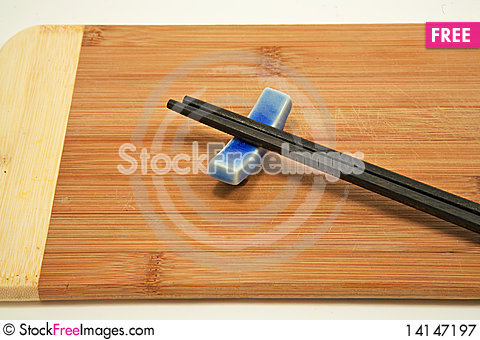 Free Close Up Of Chopsticks On Bamboo Cutting Board Royalty Free Stock Photography - 14147197