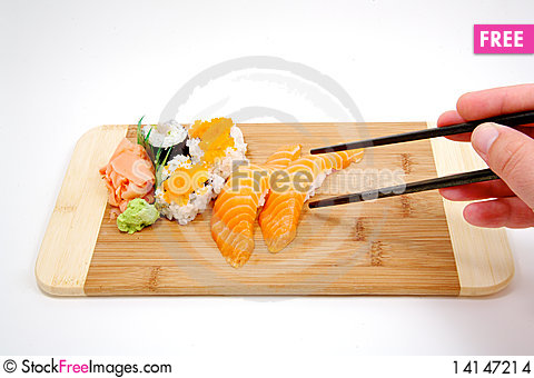 Free Trying To Pick Up Sushi With Chop Sticks Stock Images - 14147214