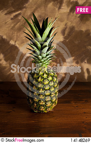 Free Pineapple On Wood Table Royalty Free Stock Images - 14148269