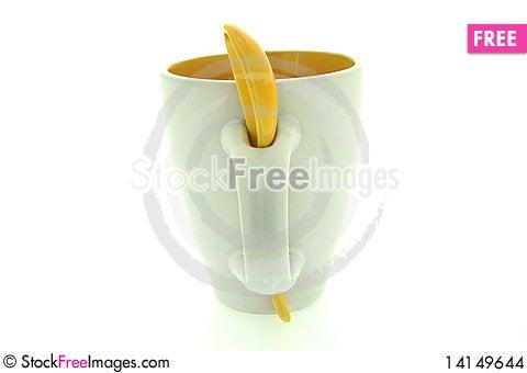 White mug and yellow spoon Stock Photo