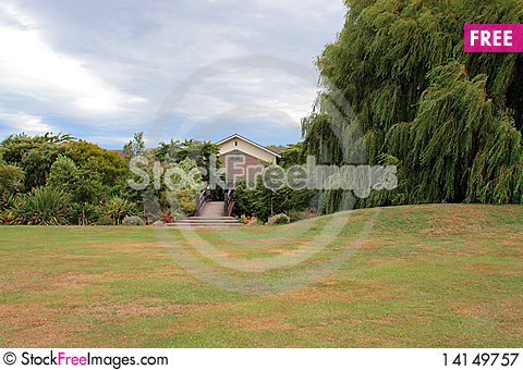 Free House And Foot Bridge Among Trees Royalty Free Stock Photography - 14149757