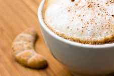 Cappuccino And Sweet Cookies On The Wooden Backgro Royalty Free Stock Photo