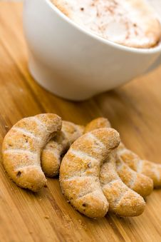Cappuccino And Sweet Cookies On The Wooden Backgro Stock Images